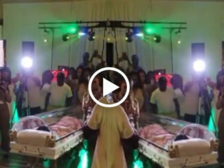 Woman happily makes entrance in a casket for her 50th birthday party