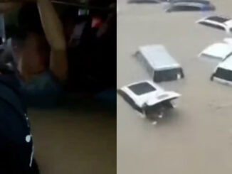Passengers 'drown in underground train' after devastating floods caused the rail system to be inundated with water (video)